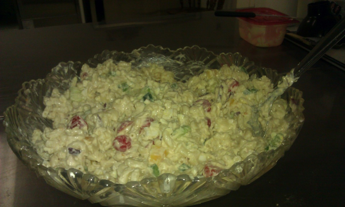This macaroni salad features bell pepper, olives, red onion, cherry tomatoes, tuna fish, and more.