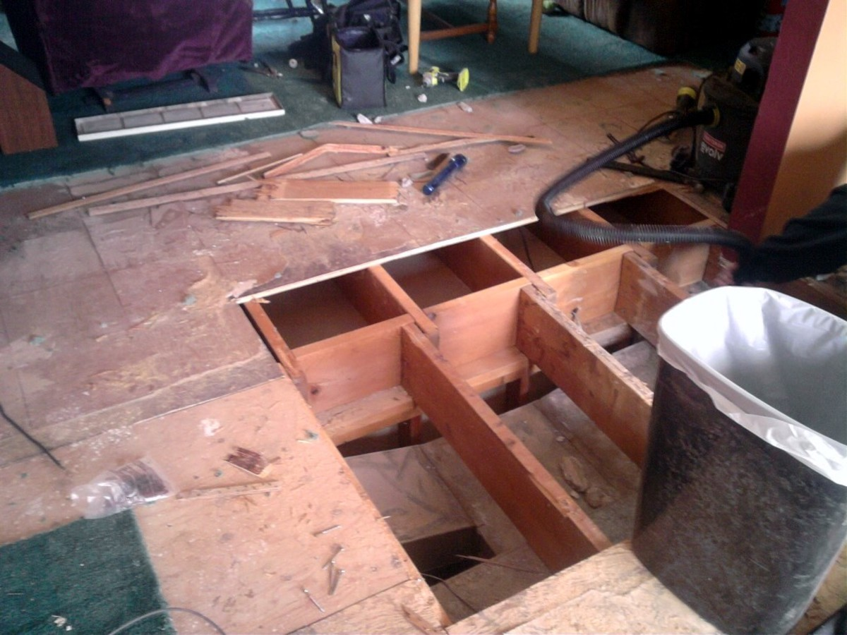 This subfloor was in very poor condition, and parts had to be replaced,  The entire floor was then covered with a second layer.