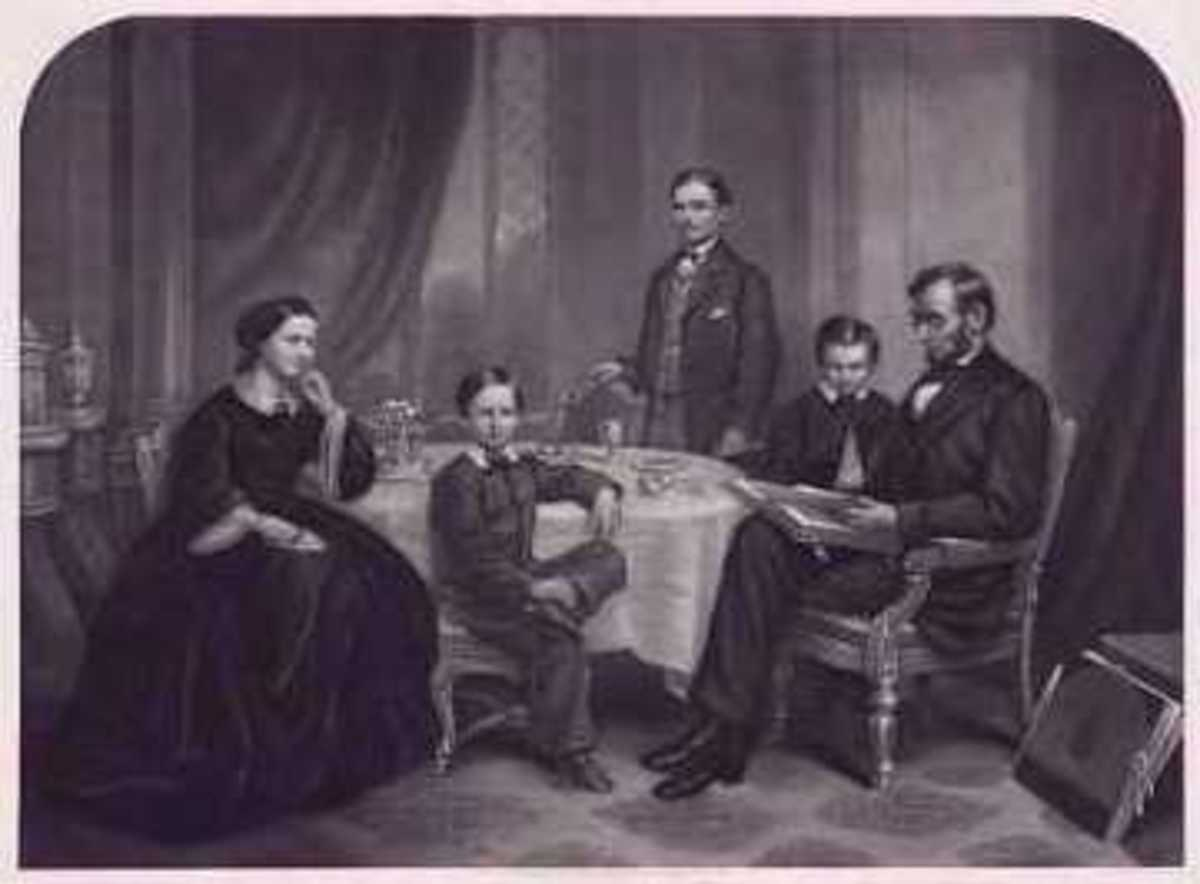 Abraham and Mary with their sons Thomas (Tad), Robert and William (Willie). Note: This is a painting by the artist Francis Carpenter. Lincoln never took a photo with his entire family or one alone with his wife.