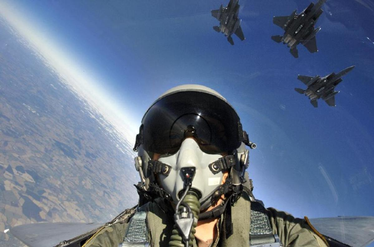 Inside cockpit of USAF F-15E Strike Eagle flying in formation with other F-15E fighters (photo courtesy of USAF)