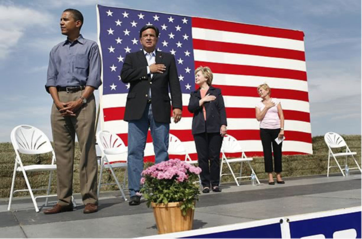 Obama pledges allegiance to the flag.