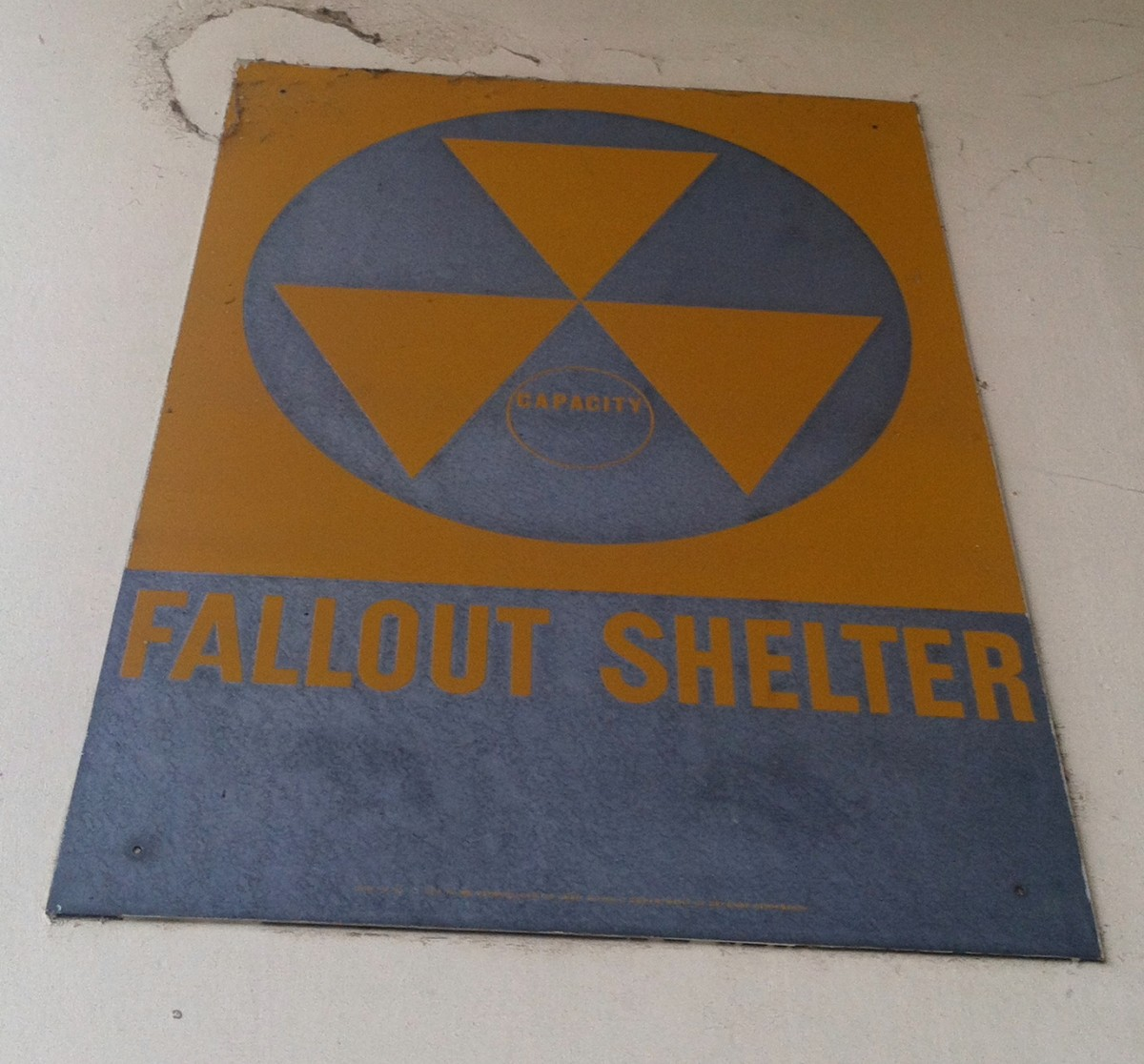 A sign indicating a fallout shelter at a government facility.  Look for these signs anywhere you go so you know where they are.
