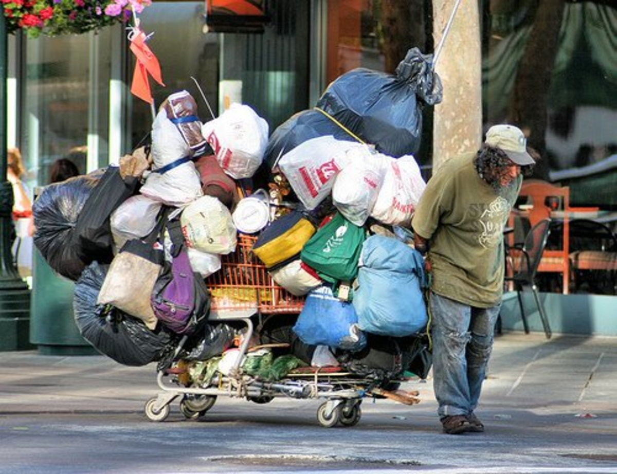 A homeless hoarder on the move in the city.