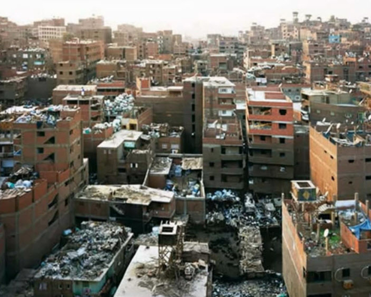 This is Manshyiat Naser -- The City of Garbage , a suburb of Cairo where all of the refuse of an overpopulated city are brought to be picked over and recycled by the poorest of the poor. Note the mounds of garbage everywhere.
