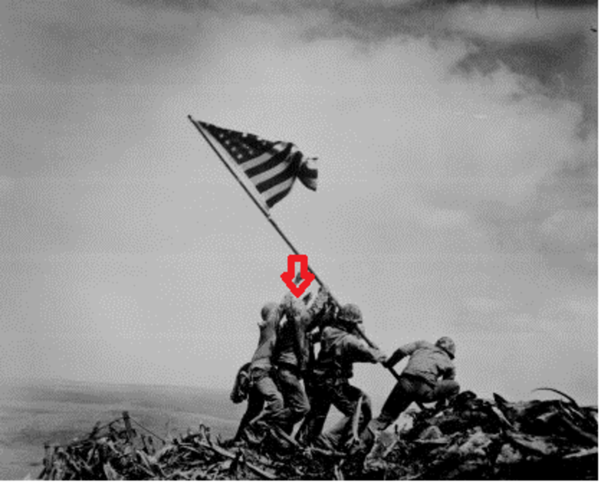 """Raising The Flag on Iwo Jima,"" by Joe Rosenthal.  Pictured left to right are Ira Hayes, Harold Schultz, Michael Strank, Franklin Sousley, Rene Gagnon, and Harlon Block.  The red arrow denotes Schultz."