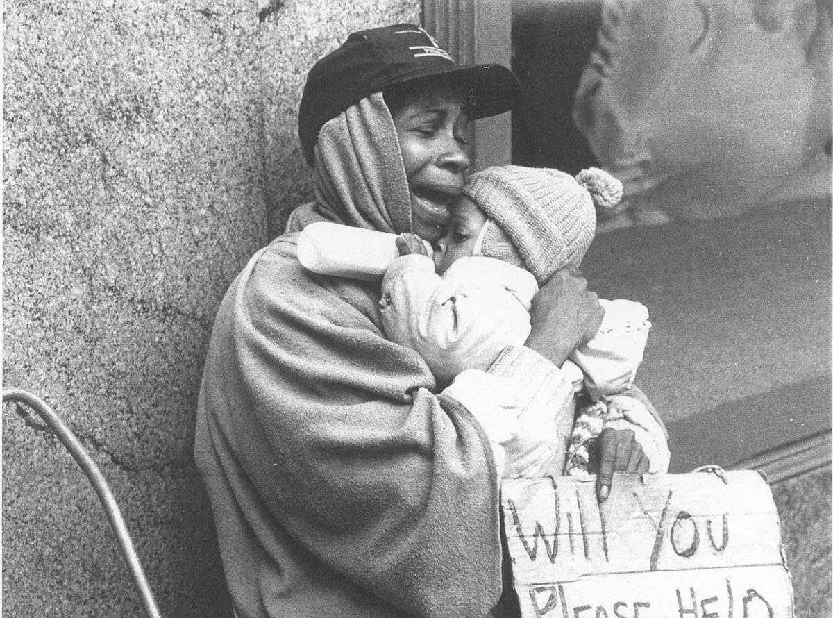 An Unidentified Homeless Mother With Her Child
