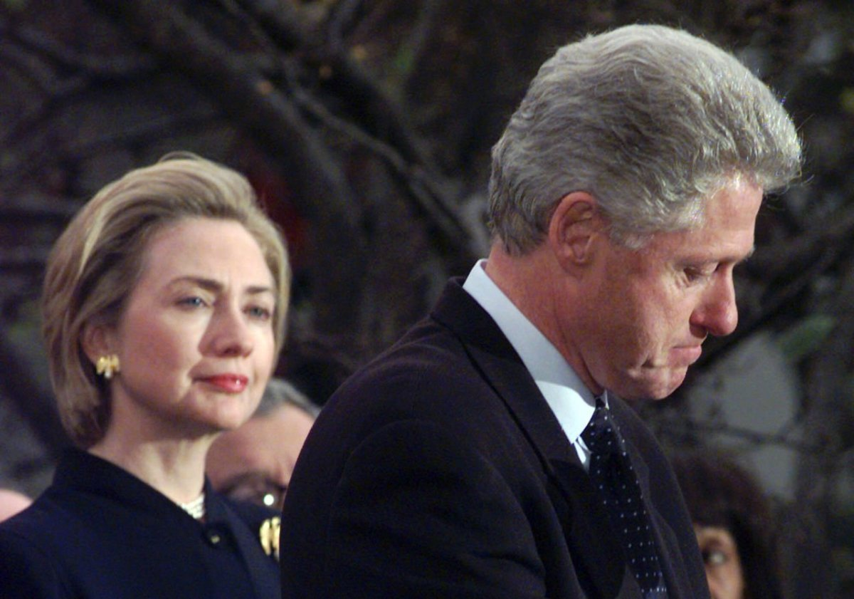 "A guilty Bill admits his ""indiscretions"" as Hillary looks on."