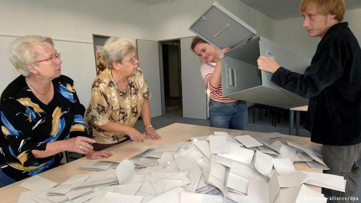 Workers begining a ballot count in a German election.