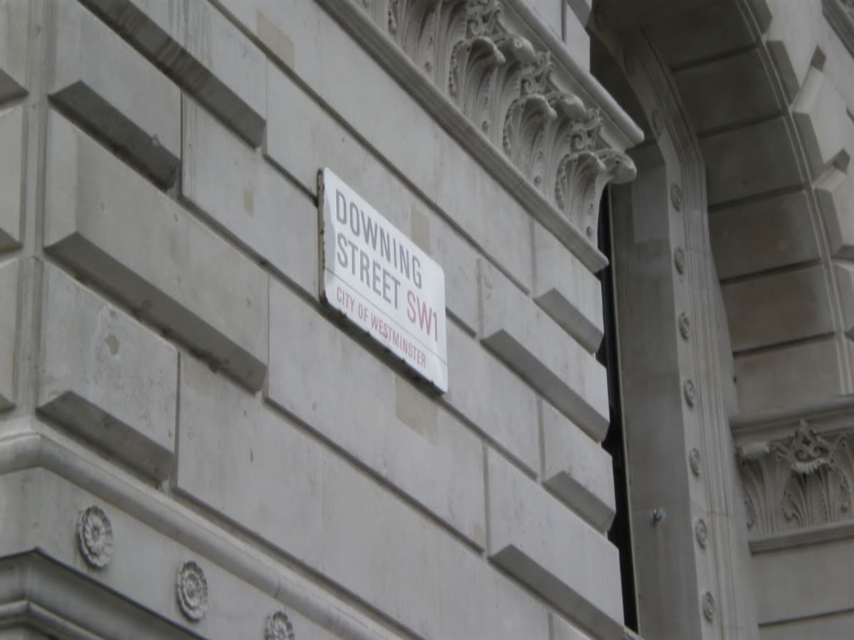 Sign pointing to Downing Street wheres Mrs May met Polish PM Beata Szydlo
