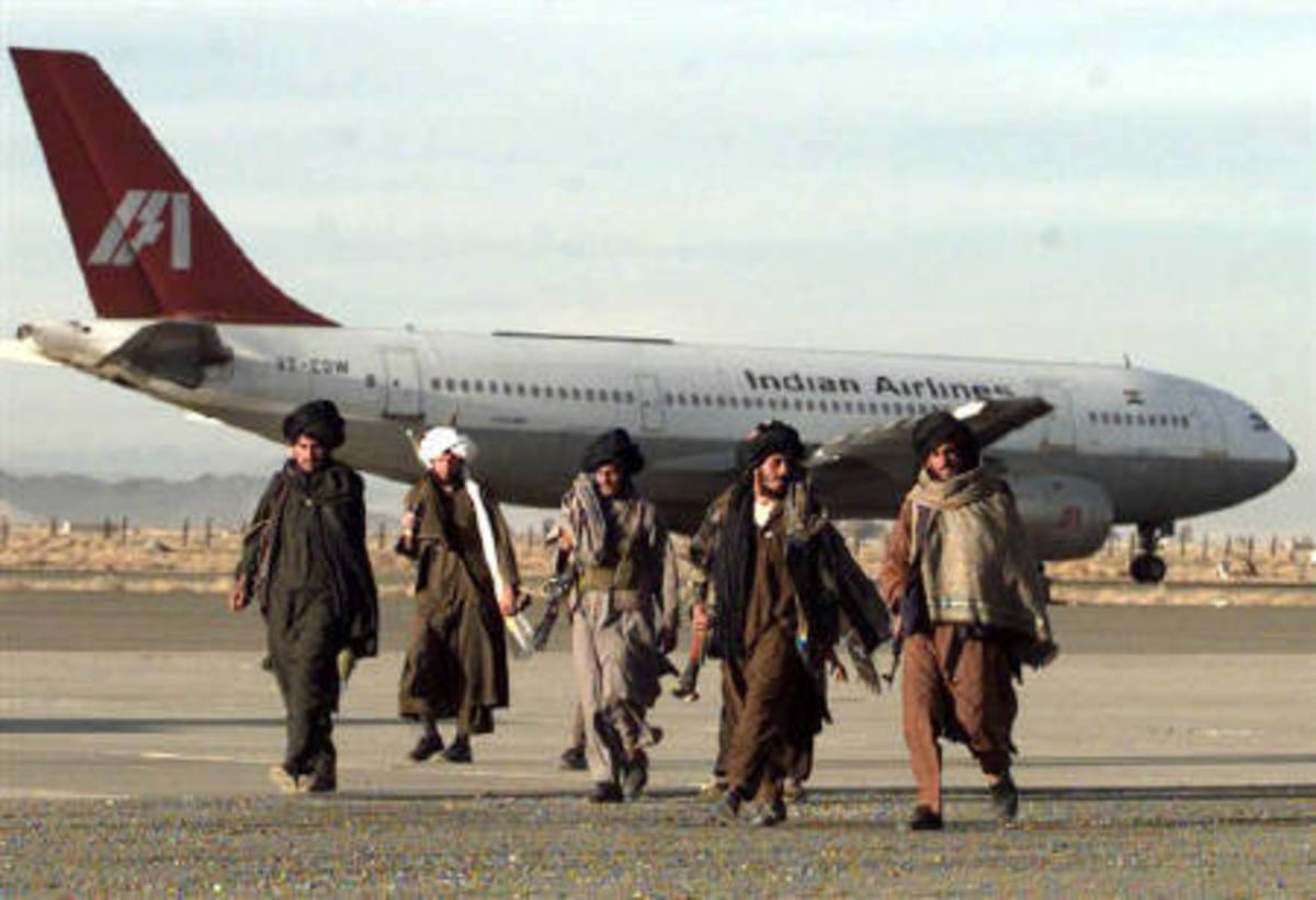 Taliban militants walking past the hijacked IC 814 flight at Kandahar Airport, Afghanistan (December 27, 1999)