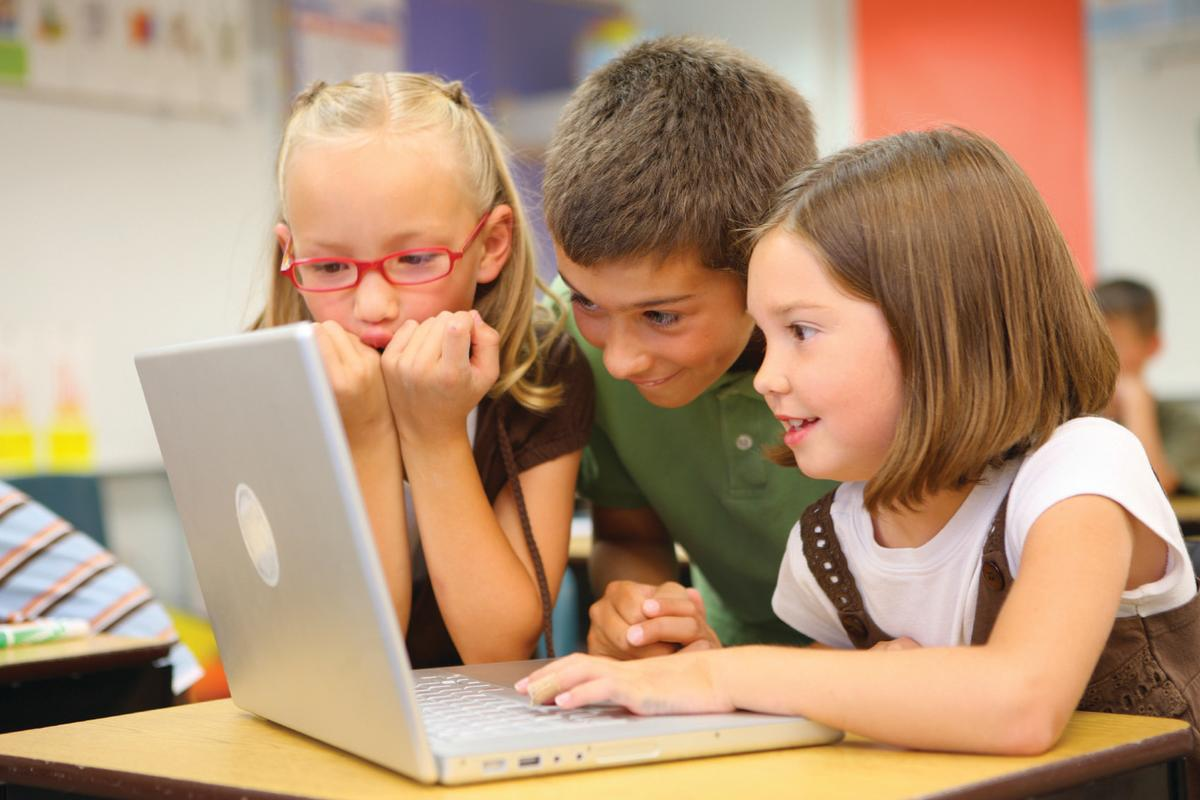 Children using technology in school