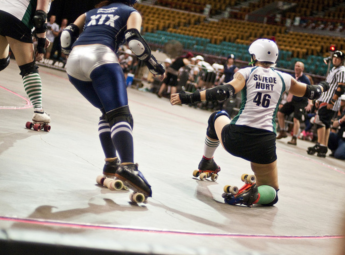 Roller derby skater taking a knee