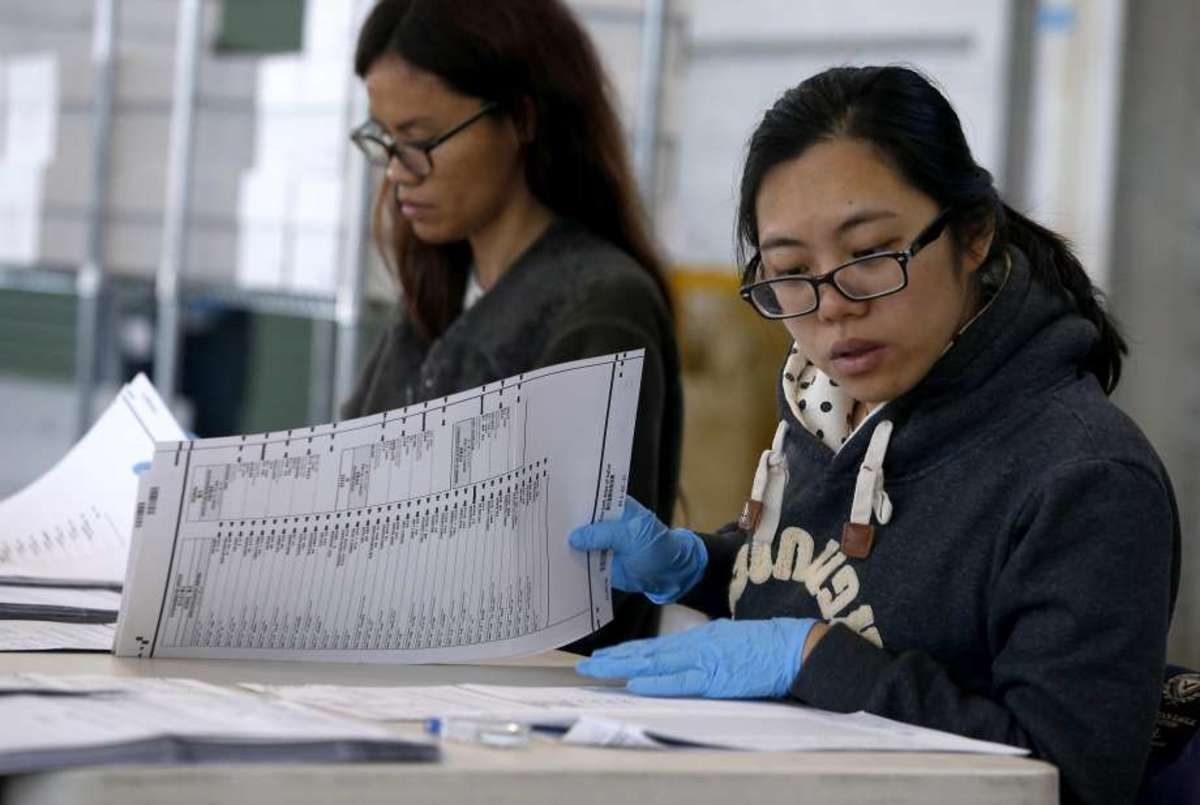 Citizens assisting with a provisional ballot count in California