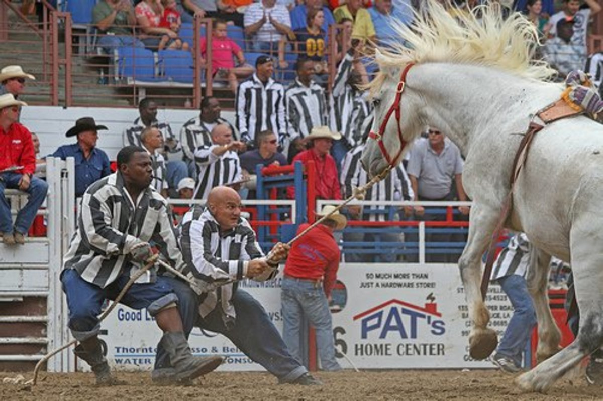 Inmates take part in the wild horse race.