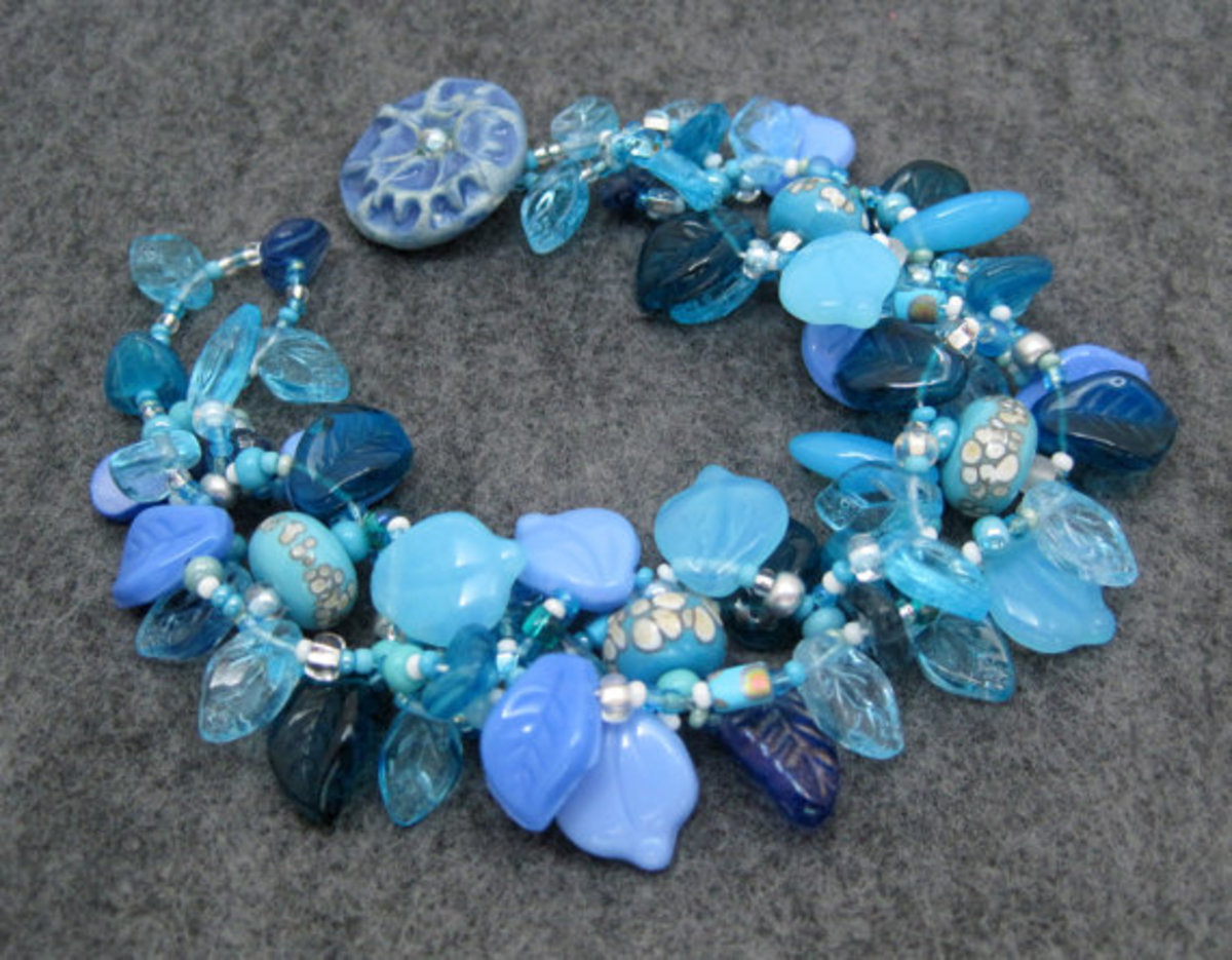 Even though I don't make a lot of beads, I love to use handmade beads in my creations.  The round blue spotted beads beads are from Jen of blueseraphim on Etsy.
