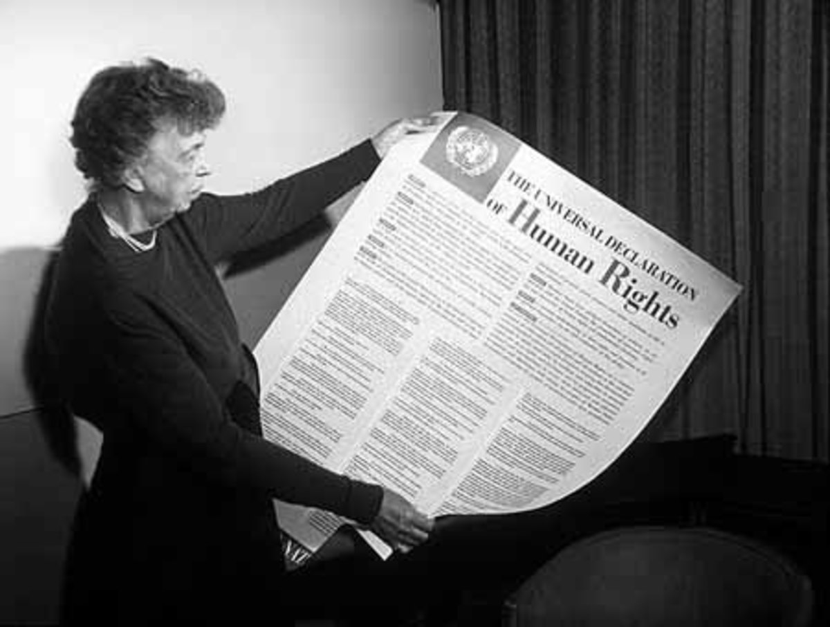 Eleanor Roosevelt holding a copy of the Universal Declaration of Human Rights.