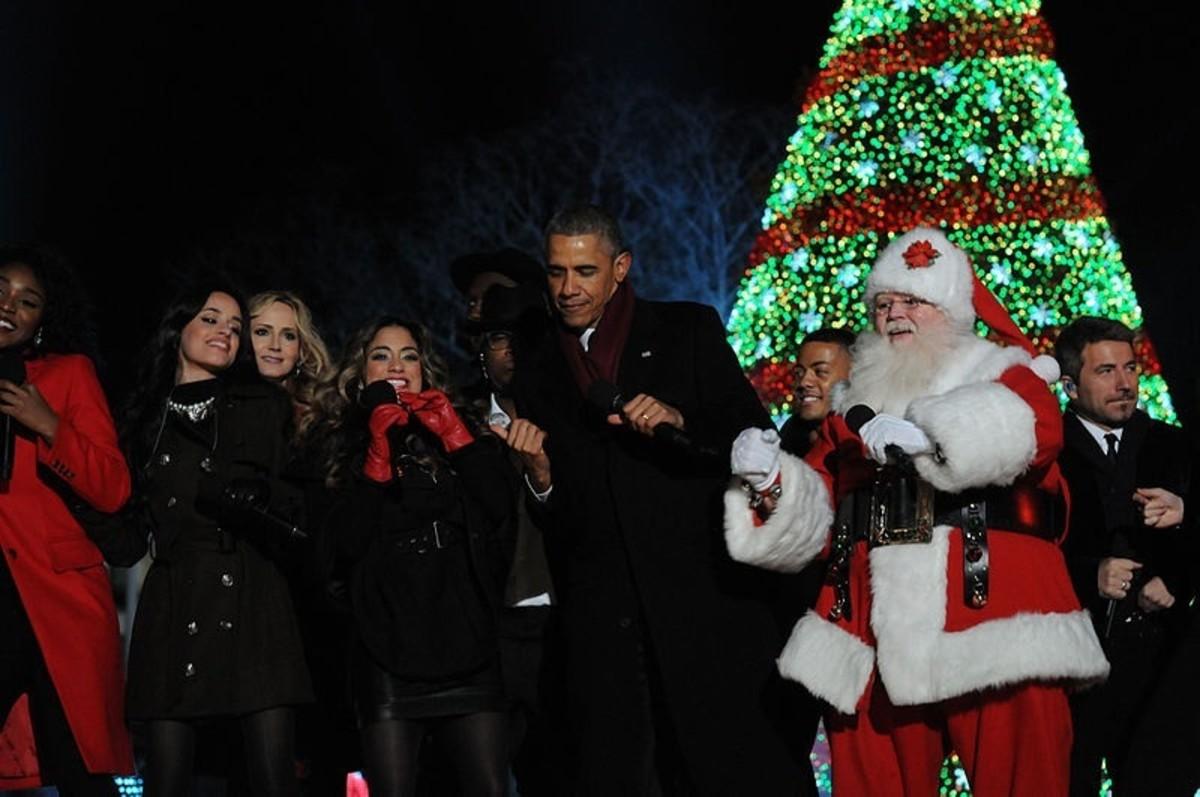 Former President Barack Obama dances with Santa Claus on December 4, 2014.