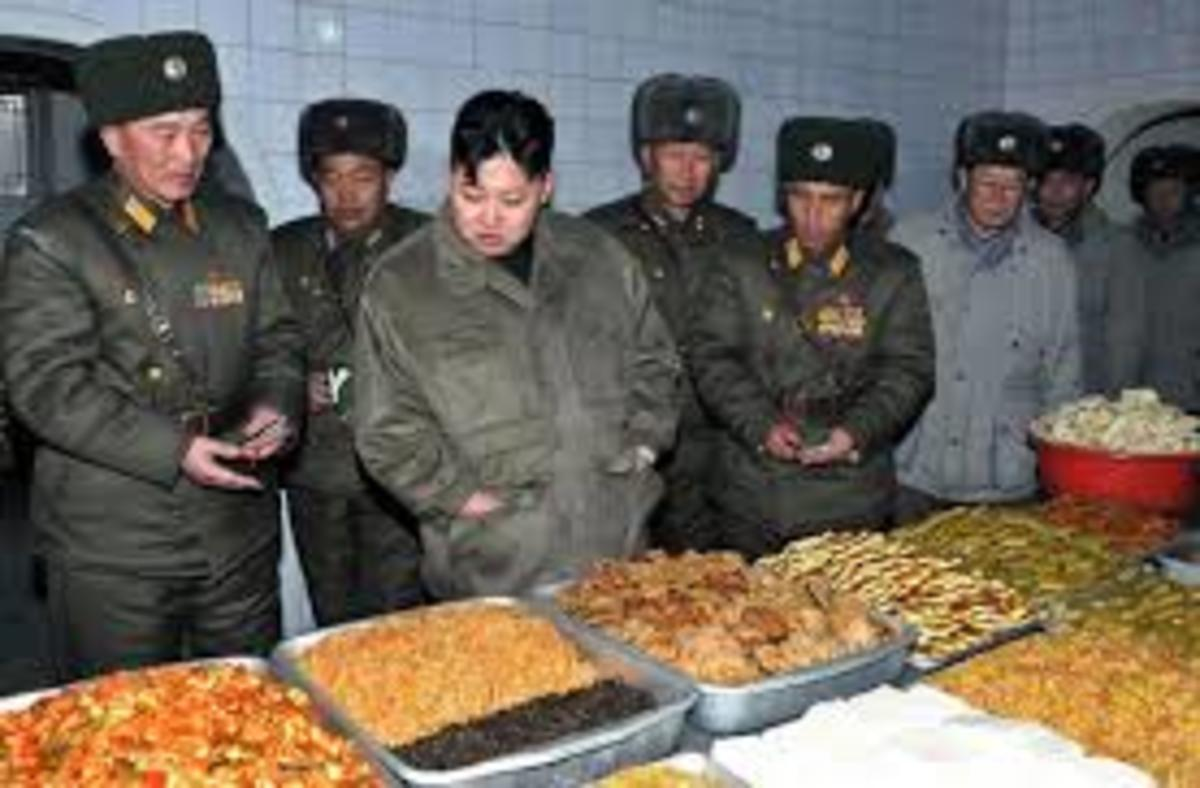 Kim Jong Un inspects food prepared for the military. In North Korea those who in power and those who protect them eat well.