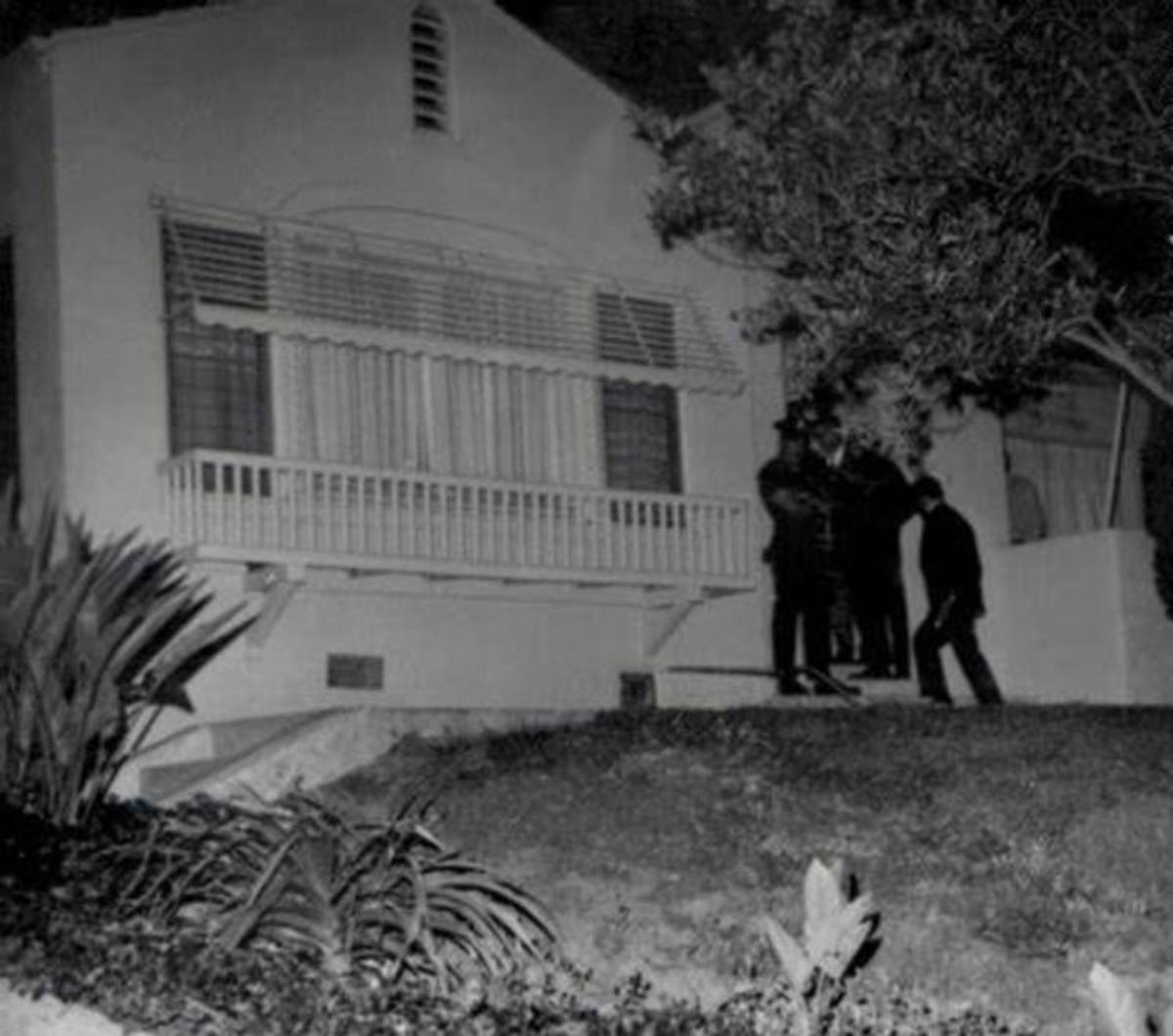 Detectives gather outside the LaBianca residence at 3301 Waverly Drive, in the early morning hours of August 10, 1969.