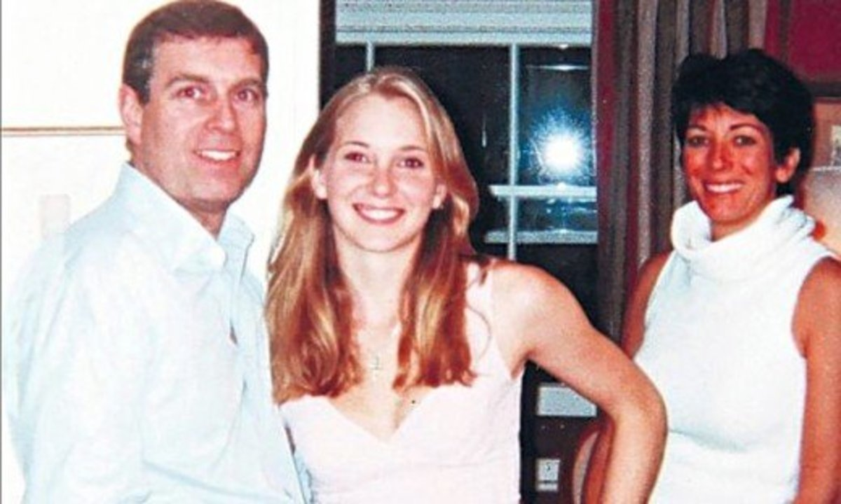 Disputed photograph which Prince Andrew calls a Photoshop, contending he never met Virginia Roberts Giuffre.  Maxwell appears to be standing in the background.