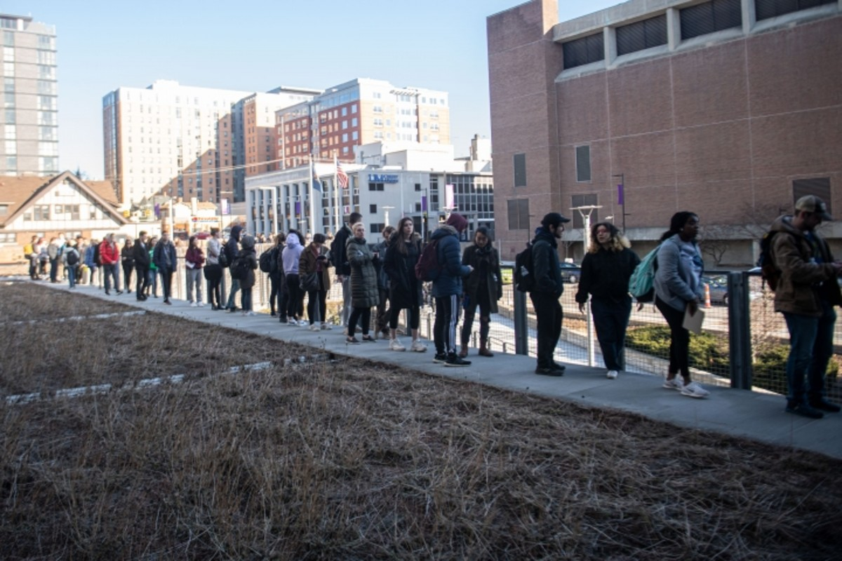 Hundreds of students and residents wait in line to register and to vote outside of Ann Arbor City Hall Tuesday afternoon.