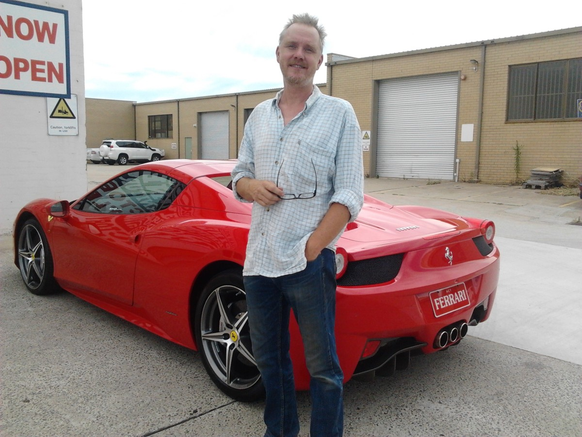 Blue jeans and a red Ferrari ... but will the real cost of a Ferrari be worth it?