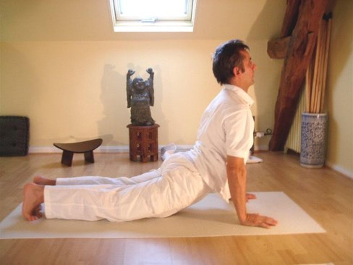 Upward facing dog is similar to Cobra Pose or bhujangasana but with the pubic bone off the floor.