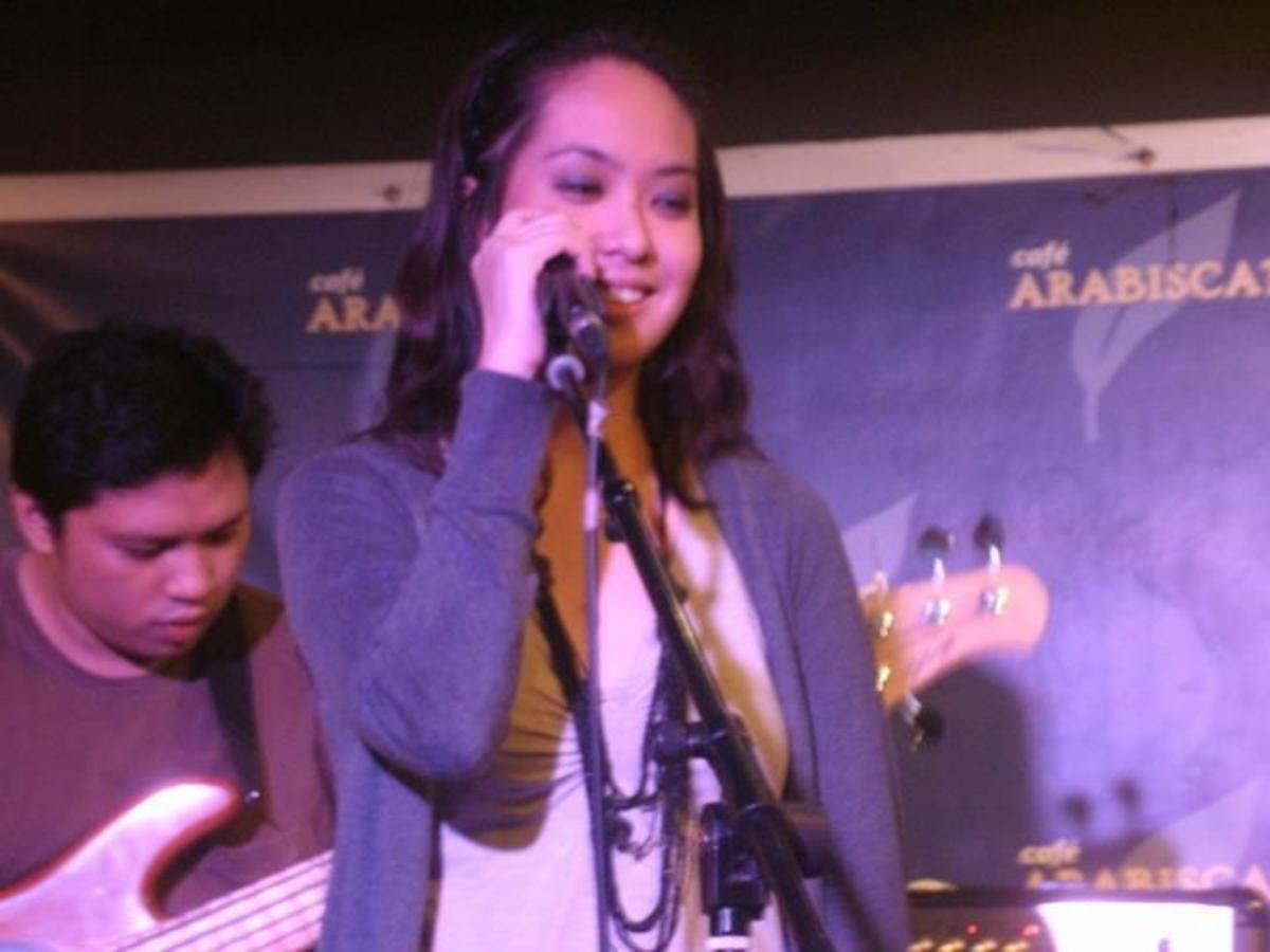 Singing in one of my band's (AMIHAN) rock gigs. Photo taken at Cafe Arabiscato, SSS Village, Marikina City