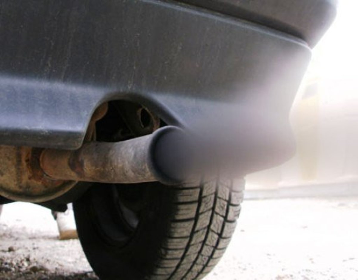 Black smoke from exhaust pipes can be easily corrected in most cases by changing the weight of oil you use.