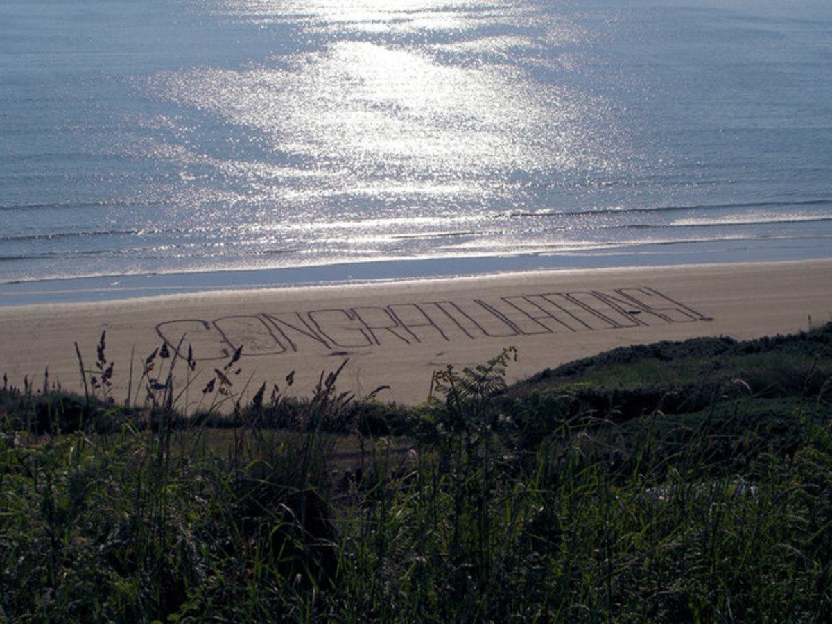 Congratulations written in the sand at the beach: I love it!