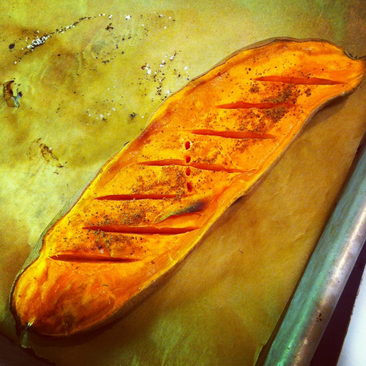 A roasted sweet potato. You can tell it's a sweet potato because of the orange interior flesh. This is one of two types of sweet potatoes sold in US markets.
