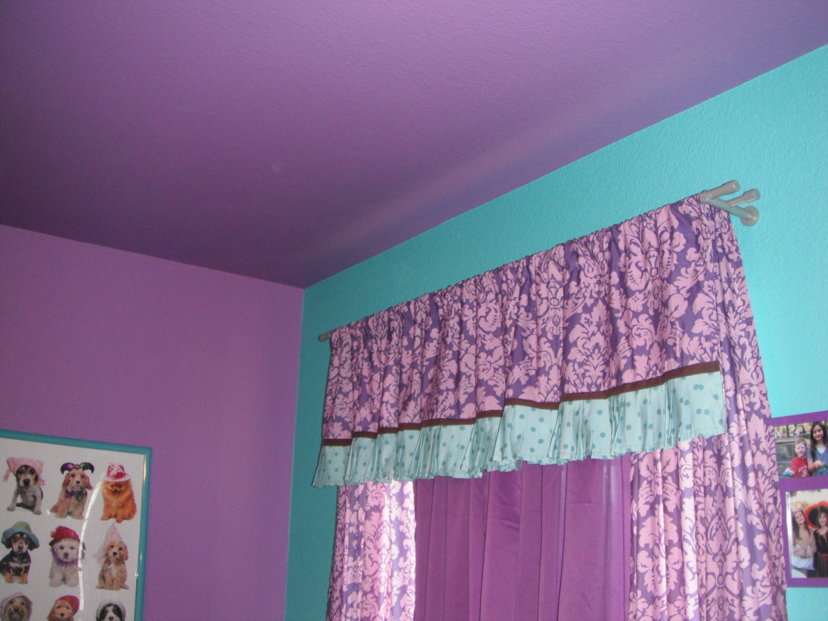Puple and tuquoise walls with a purple ceiling is my daughter's dream combination.