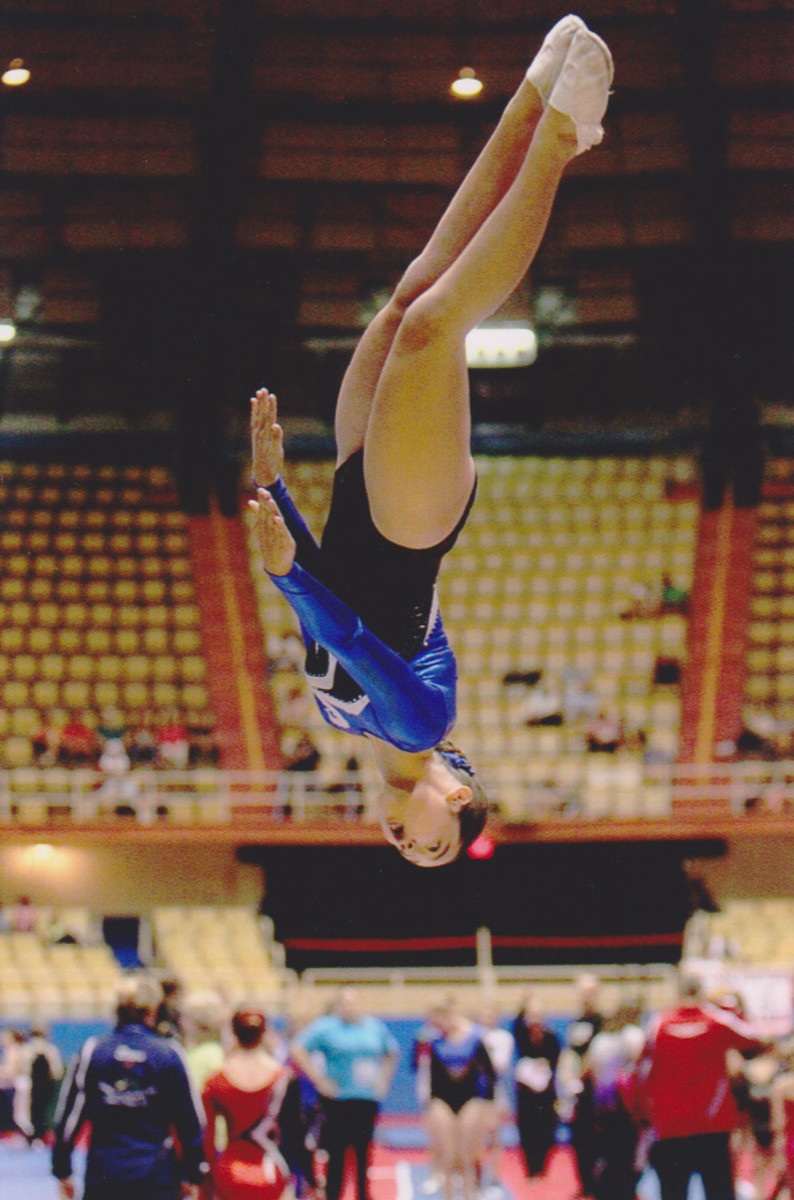 My own daughter competing at the USAG Junior Olympic Trampoline &Tumbling National Championships. She is completing a half twist (barani) in the air during her double mini trampoline dismount.