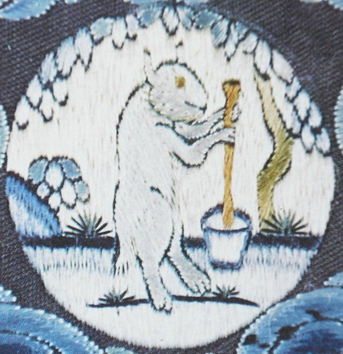 A medallion on an 18th century Chinese emperor's robe depicting the Moon Rabbit mixing its elixir  of life at the foot of a cassia tree.