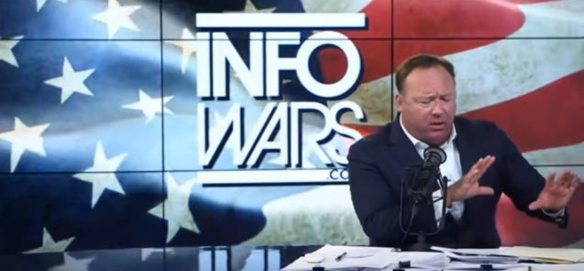 Alex Jones lips are moving.  Guess what he's doing?