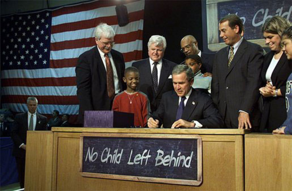 Visiting Hamilton High School in Hamilton, Ohio, Jan. 8, 2002, President George W. Bush signs into law the No Child Left Behind Act.