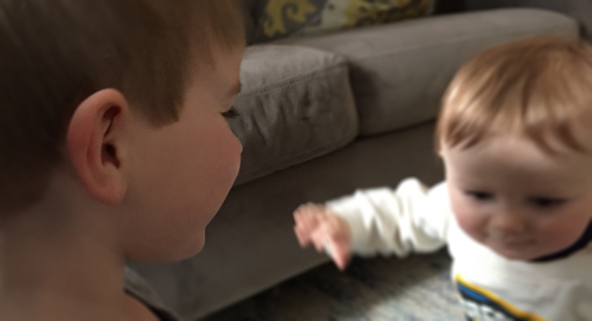 My oldest playing with his baby brother.