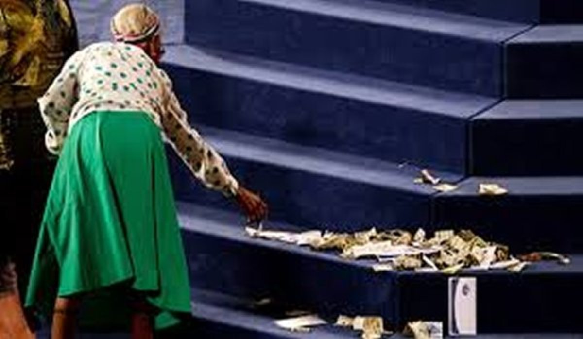 Churchgoer is laying money on the altar in response to what the preacher has said.
