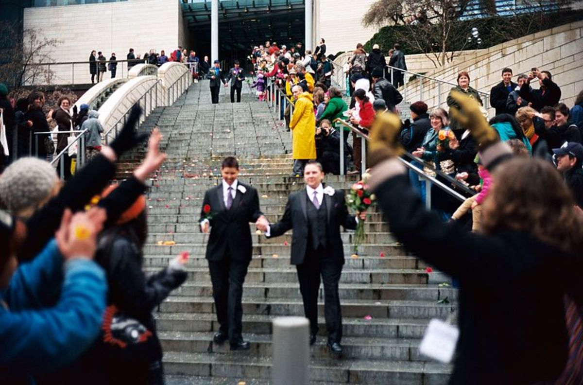 Recently married couples leaving the City Hall in Seattle on the first day of same-sex marriage in Washington state after enactment of Washington Referendum 74.