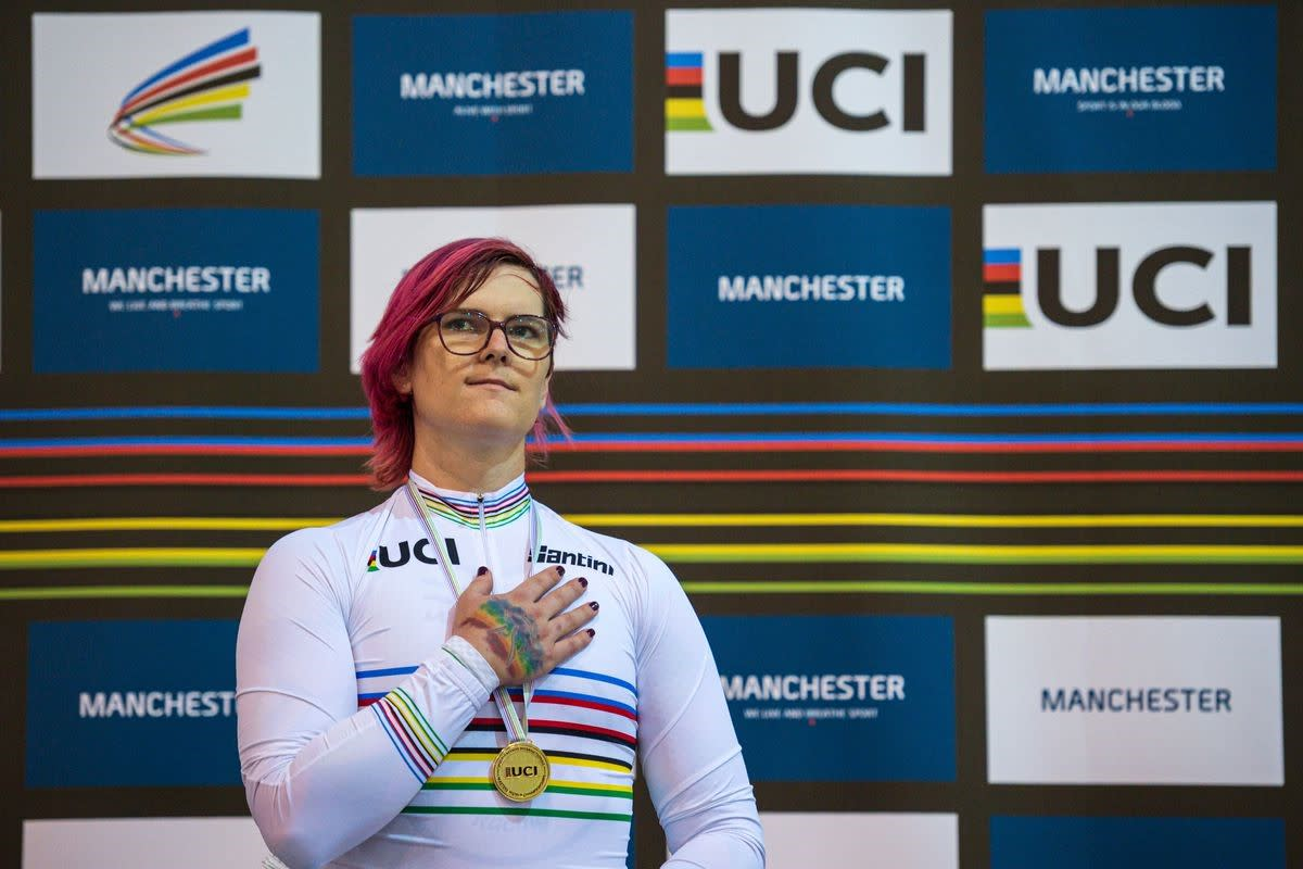 Transgender cyclist Rachel McKinnon on the podium with a gold medal.
