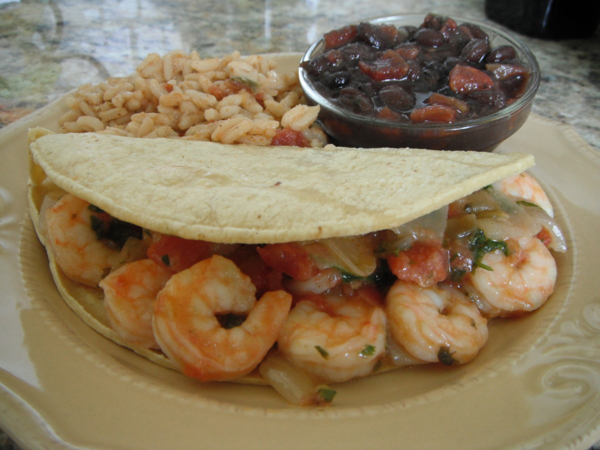 Soft corn tortillas brimming with shrimp, caramelized onions and diced tomatoes and cilantro; especailly delicious with guacamole. Served with rice and black beans on the side.