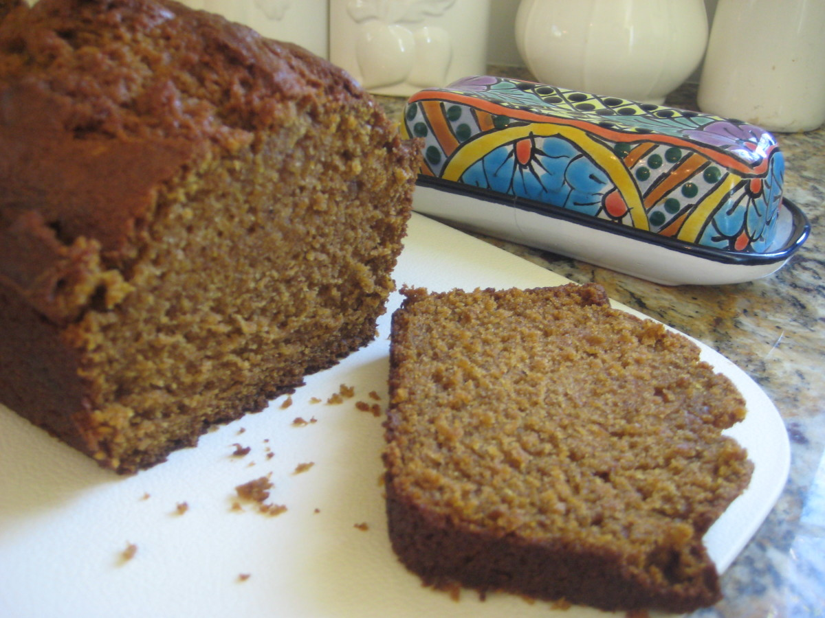Moist, tender and delicious pumpkin bread with a bit of a healthy twist. I've set the butter dish out, but this moist bread doesn't need it!