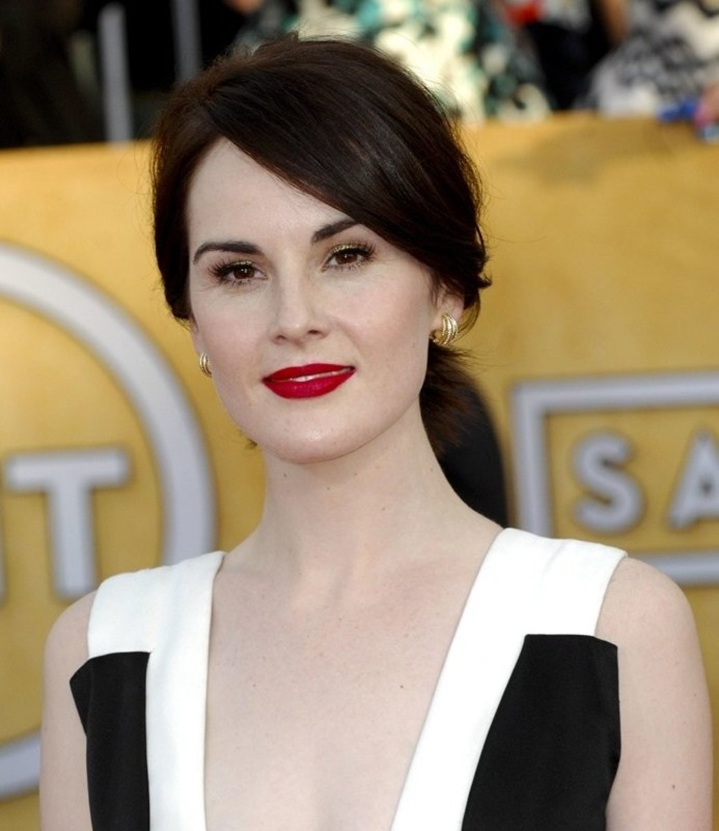 Michelle Dockery with dark red lipstick and alabaster skin