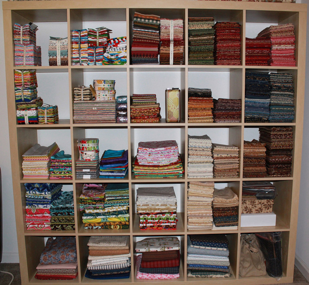 This quilter has a large, neatly organized, stash of fabric.