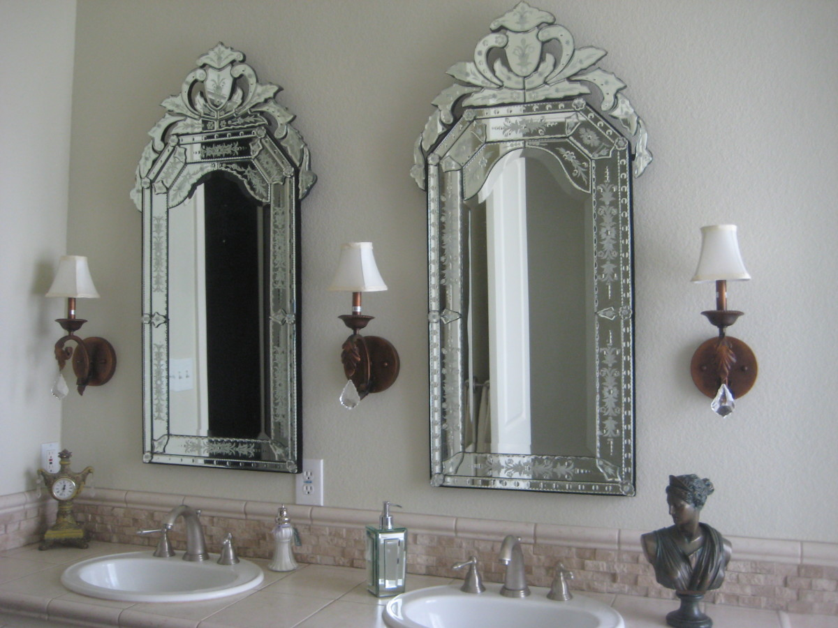 Replace a boring plate-glass mirror with somthing beautiful, fun or exciting. I love Venetian glass mirrors, as they provide plenty of lovely sparkle and elegance, much like a crystal chanedlier does.