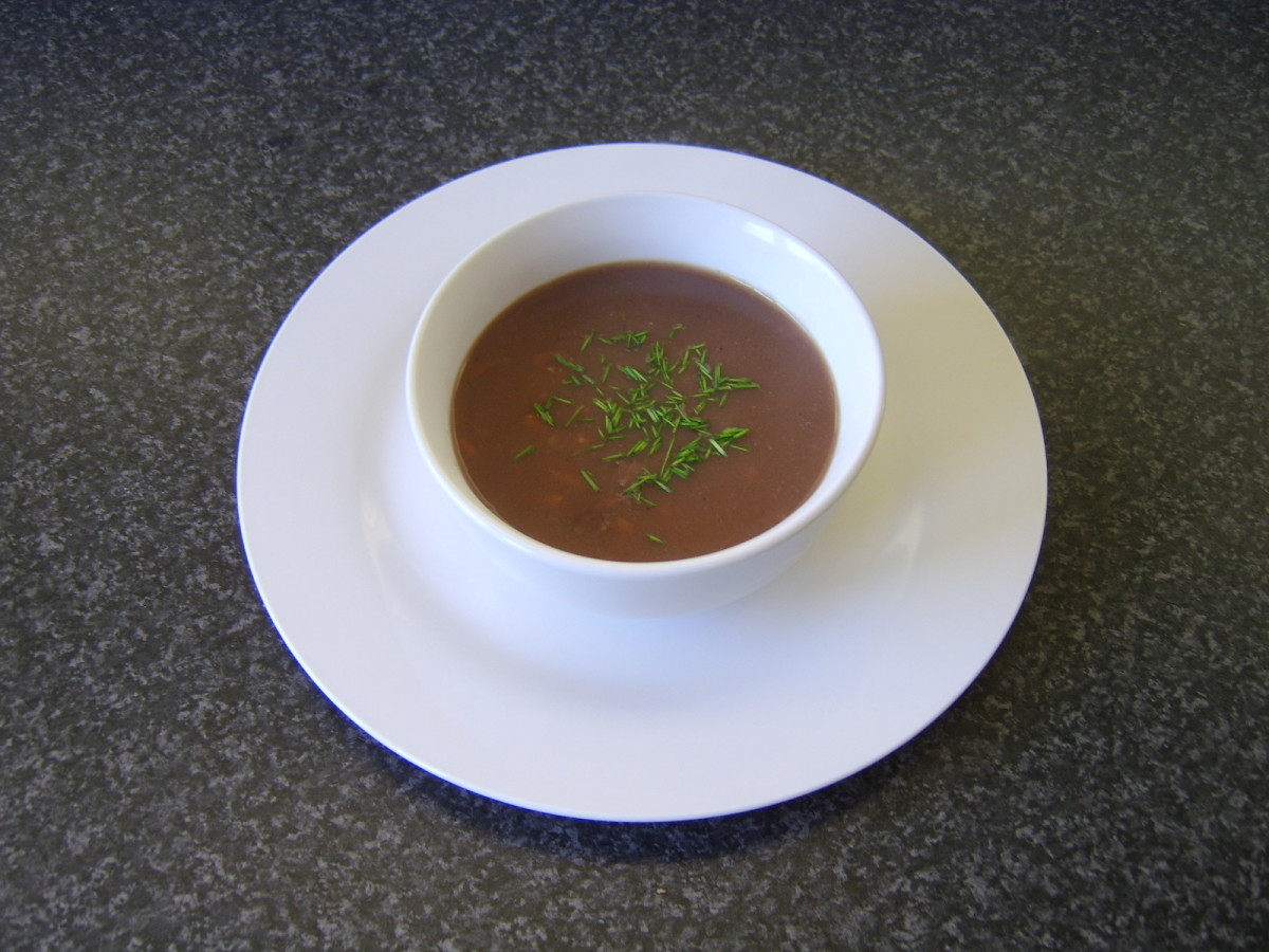 Homemade oxtail soup is simply garnished with chopped fresh chives