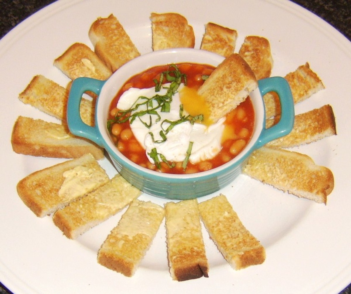 Baked beans with a poached egg and toasted dipping soldiers.
