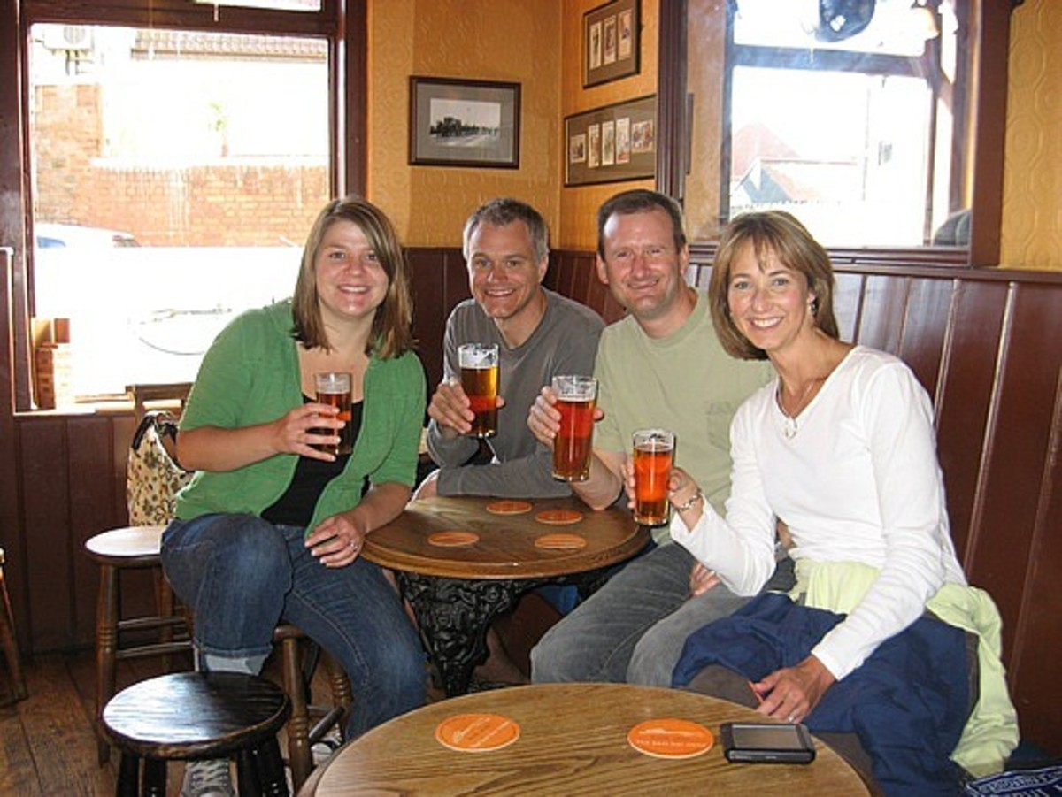 Cheers! Four happy drinkers in the lounge bar of a pub.