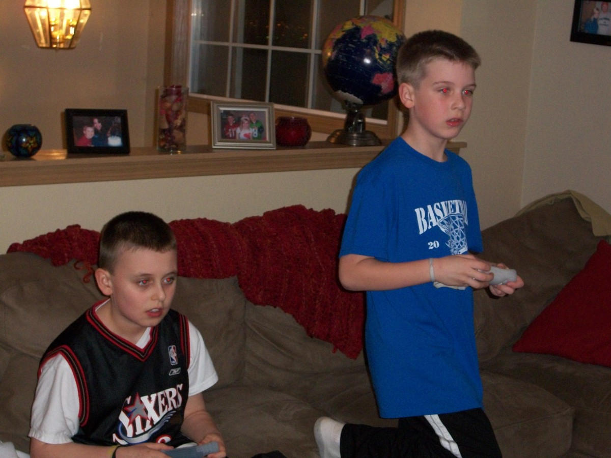 Boy with Asperger's and a friend playing different video games side by side