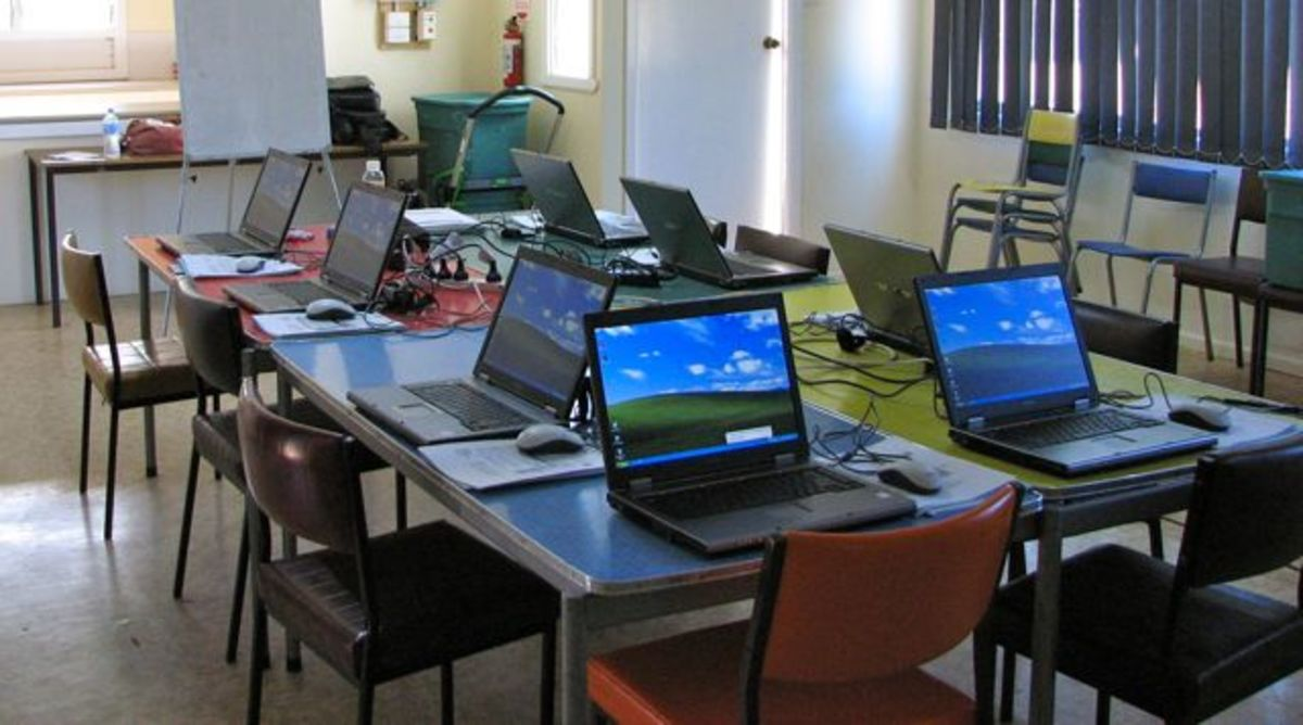 A training course for elderly members of a rural community to learn how to use computers and the internet.